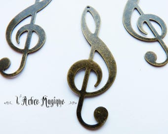 bronze 4 fancy treble clef pendant 19 x 53 mm