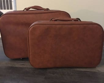 Pair of vintage leather suitcases