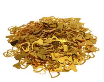Gold heart confetti. table confetti