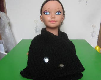 Black scarf made with a giant knitting