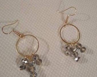 Faceted beads and gold earrings