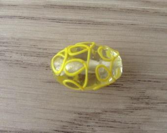 Glass bead transparent yellow embossed NET
