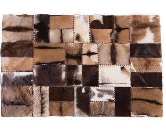 """Luxury Brown Sustainable Sourced Goat Skin Patchwork Area Rug, Genuine Goat Skins, Multiple Goat Skins Hand Stitched Together,  4'7"""" x 6'7"""""""