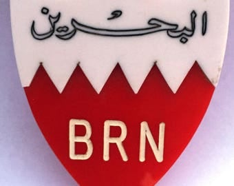 Bahrain Car Badge.  This emblem is made from 11mm thick plastic. Purchased in Bahrain in 1971. As new and never used.