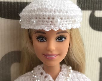 Crocheted white suits for Barbie