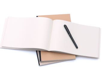 Hand made sketchbook / notebook, ~A4 with plain cover and off white inner paper (245x175 mm)