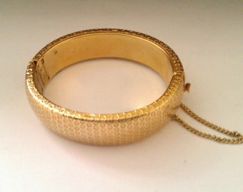 gold coloured hinged bangle