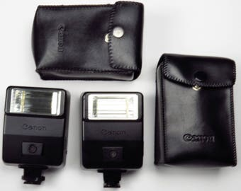 TWO Vintage Canon Speedlite 155A Shoe Mount Camera Flash with Soft Case Made in Japan TESTED WORKING
