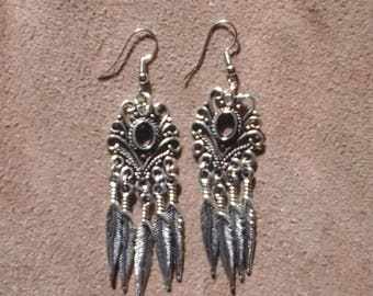 Chandelier Feather earrings.
