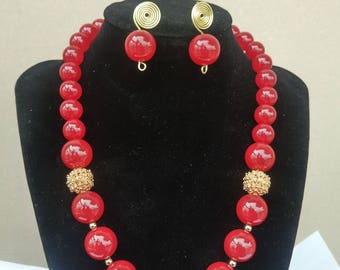 Red and gold detailed jewelry