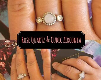 Sterling silver engagement or stacking ring with rose quartz and cubic zirconia.