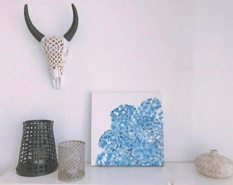 Blue hydrangeas with gold