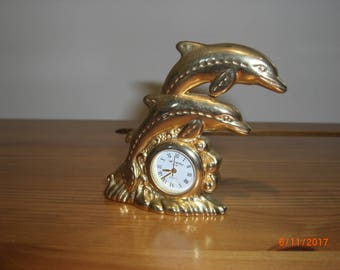 Metal gold dolphin clock , made in 1980's