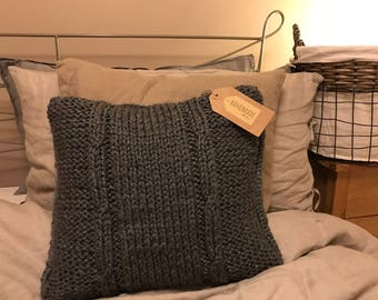 Grey knitted cusion
