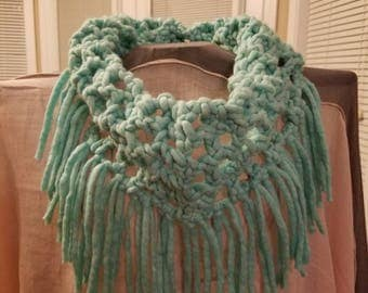 Lovely color, bulky infinity scarf with fringe.