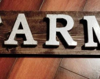 Handmade wooden sign with metal cutout of FARM