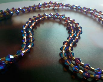 "Necklace ""Blue / Amethyst"" Swarovski Crystal gold plated."