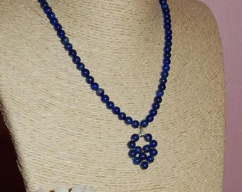 Necklace + pendant, while Lapis Lazuli