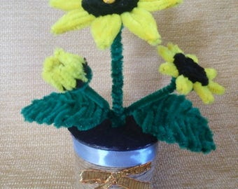 Sunflower with a bee in a pot made of velvet