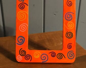 Orange glow in the dark picture frame