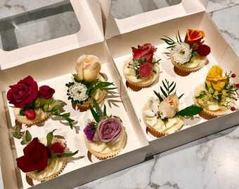 Cupcakes topped with fresh flowers