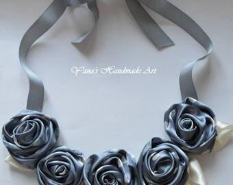 Textile grey necklace.