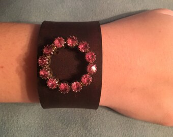 Leather cuff with vintage brooch