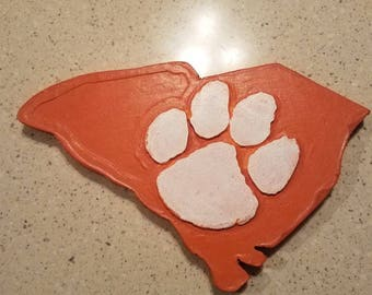 State is SC with raised Clemson  paw