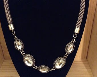 Beautiful necklace with five large silvertone crystals and adjustable length silver rope chain