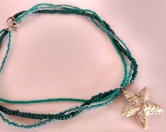 Handmade polymer clay starfish pendant on beaded necklace