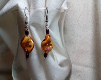 Glass bead earrings, gold and pink paint
