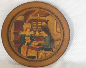 Carved wood painted decorative plate