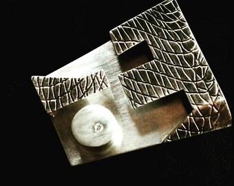 First Law silver zirconium crimp brooch