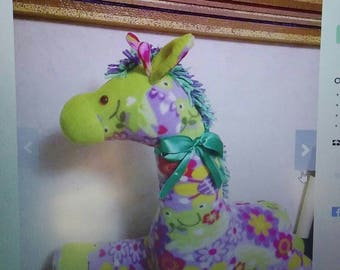 Giraffe in fleece bold multicolors. Hypoallergenic stuffing. Safety lock eyes. Yarn main n tail. Measures 25 inches long.