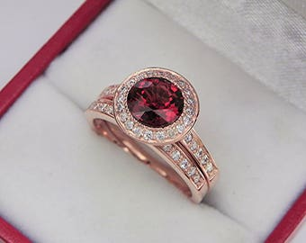 AAAA Red Sapphire 7.0mm  1.54 Carats   14K Rose gold bridal set with .35cts of diamonds. 0501