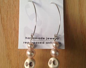Pearl Muertos Skull Earrings