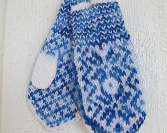 Handknitted norwegian mittens for children in white and multi blue