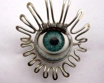 Doll eye brooch