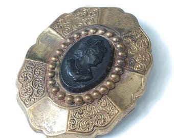 Victorian Era Black Cameo Brooch Chased and Smooth Segmented Setting