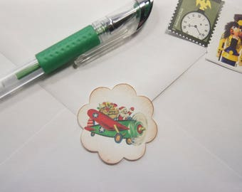 Santa Envelope Seals or Stickers Santa Delivering Toy in Airplane set of 20 1.5 inch scallop circle - SES378