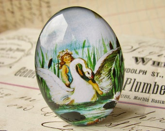 Fairy riding on a swan, handmade 40x30 40x30mm  glass oval cabochon, fantasy stories, Victorian children's books, blue, green, flower crown
