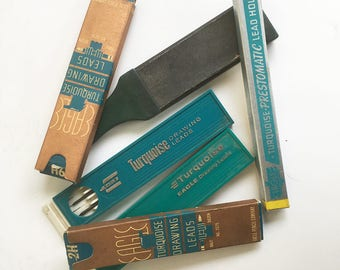 A Bundle of Vintage Eagle Turquoise Brand Drawing Leads, Lead Holder, Emery Paper Sharpener - Vintage Artist & Drawing Supplies