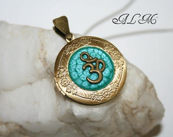 Photo with OM symbol beaded turquoise background (p) pendant