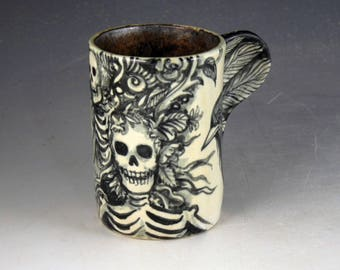 Day of the dead bird cup with skeletons skulls black and white with gold  interior black birds