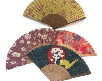 4 assorted vintage Japanese Sensu Fans, fabric and bamboo floral on ocher, sakura on plum, calligraphy, kimono fabric