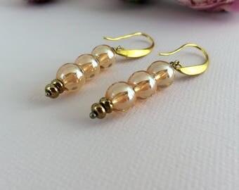 Bohemian wedding dangle earrings. Handmade bridal earrings in rose gold crystals. Elegant wedding earrings. Dangle earrings. Artisan bride.