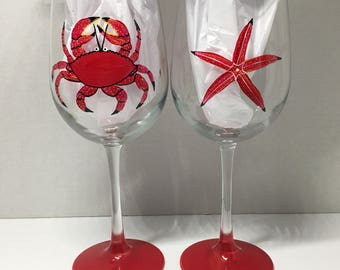 Red crab and starfish hand painted wine glasses.