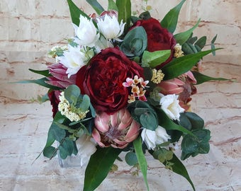 Protea, Peony Bouquet. Protea, burgandy red peony, waxflower, blushing brides, eucalyptus. Rustic native wedding flowers. Burgandy bouquet