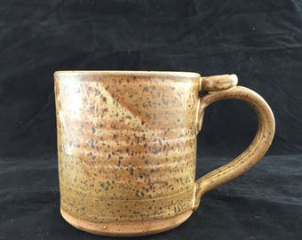"4"" Tall Stoneware Pottery Mug with High Fire Glaze. Holds 16 ounces of your favorite beverage."
