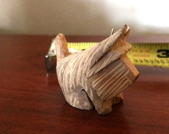 2 small handcarved wooden scotties